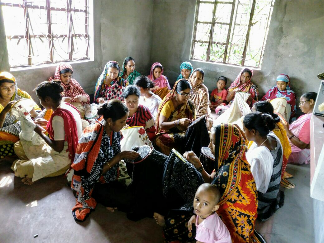 Rural women making kantha stitch weaves in Bengal